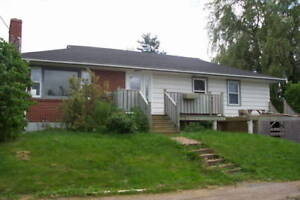 Highland Ave, Wolfville, steps from Acadia. 3-br main floor apt