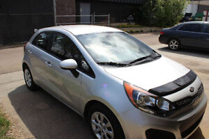 2014 Kia Rio LX+ and 9 tires and rims! Remote start, etc...