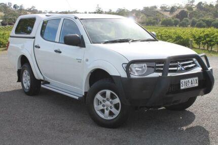 2013 Mitsubishi Triton MN MY13 GLX Double Cab White 4 Speed Auto Seq Sportshift Utility Gepps Cross Port Adelaide Area Preview