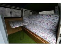 VW T25 interior for sale!! Full width bed/seat with storage and upholstered mattress.