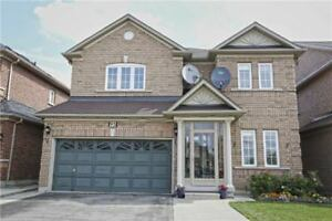 A Bright And Spacious 4 Bed House Sits On Beautiful Ravine Lot!