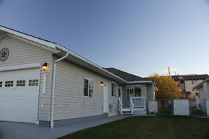 Bright, 4Bd/3Bth, attached garage.