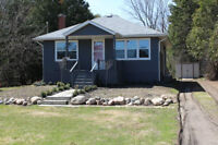 Updated bungalow with finished basement (REF# S215064)