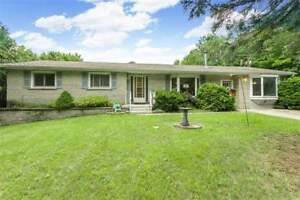 Raised Bungalow In Desirable Location Awaits You! Must See!