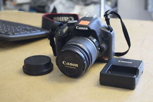 Canon EOS T1I with EFS 18-55mm with Charger and Camera Strap**