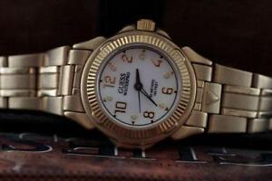 AUTHANTIC  DESIGNER GUESS WITH LOGO LADIES WATCH FOR SALE