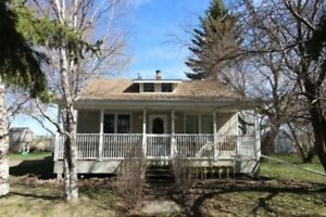 Charming Acreage Close to Blackfalds, Joffre and Red Deer!