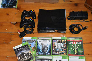 Black Xbox 360, 2 wireless controllers, 9 games
