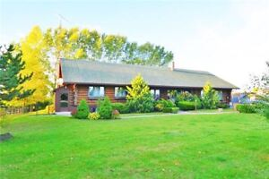 Custom Built Fabulous Log Home on Half an Acre In Lawsuite
