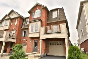Freehold Corner Townhome in Exclusive Hawthorne Village