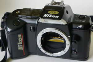 Variety of photo items: Nikon, Tamron, Crumpler, Minolta, flash