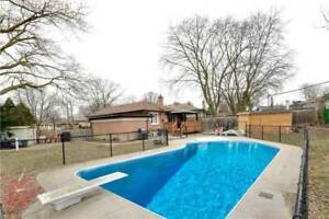 OPEN HOUSE! Renovated Bungalow Situated On A Large Pie Shaped Lo