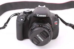 **--canon T3i + lentille 50mm en excellente état,**--