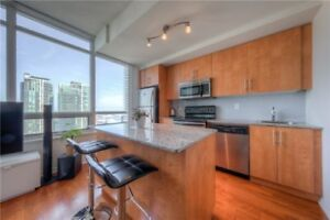Spacious 1+Den Corner Unit With Walk-Out Balcony