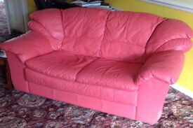 Pink Leather Sofa 1 x 3 seater. 1 x 2 seater. 1 x chair. 1 x pouffe. Good condition