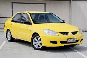 2006 Mitsubishi Lancer CH MY06 ES Yellow 5 Speed Manual Sedan Springwood Logan Area Preview