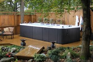 Hot tubs and Swim spas 50% off $1 down 1 year no payments.
