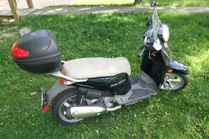 Great commuter scooter only 800 kms Comes with helmet carrier