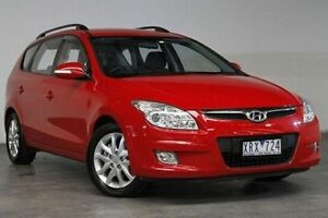 2010 Hyundai i30 FD MY10 SLX cw Wagon Red 4 Speed Automatic Wagon Southbank Melbourne City Preview