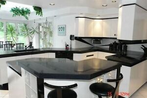 countertops in Quartz or Granite (B) 40% off on selected slabs