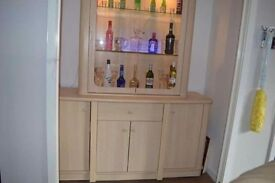 Glass display unit with large sideboard