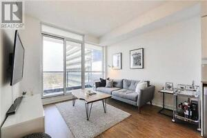 ** Rarely Offered Unobstructed North Facing 1Br + Den Condo **