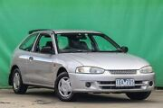 2003 Mitsubishi Mirage CE MY2002 Silver 5 Speed Manual Hatchback Ringwood East Maroondah Area Preview