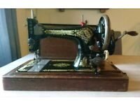 Vintage Singer Sewing Machine in wooden carry box with manual and tools