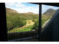Double bedroom with an ensuite bathroom in a spacious flat with stunning views of Arthur Seat