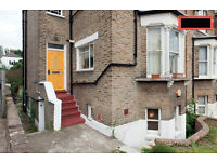 Beautiful light spacious semibasement 1 bed flat for sale. Garden access & 3 min walk to rail links.