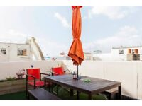 Fully furnished top floor two bedroom flat, with a fantastic roof terrace and sea views.
