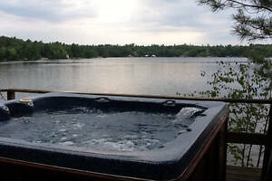 Muskoka cottage with outside hot tub and open wood fireplace