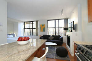 Stylish Yaletown Condo with Fireplace, Den and Parking Dec 22