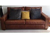 Beautiful three seater chocolate brown sofa