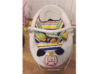 M&P baby bouncer chair rocks and vibrate & plays music
