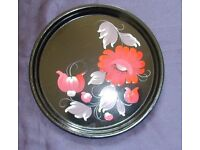 Small, decorative metal serving tray.