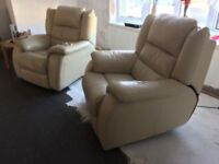2 Cream Leather chairs with electric recliners.