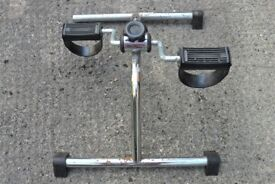 Pedal Exerciser for arms or legs.