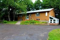 Two kitchens, two laundry rooms, nearly two acres!