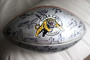 The Hamilton Tiger Cats signed football by players dated back