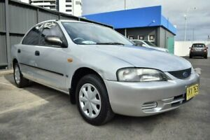 1998 Ford Laser KJ III (KM) LXI Silver 4 Speed Automatic Sedan Liverpool Liverpool Area Preview