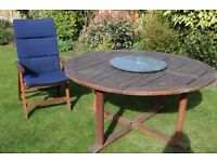 Teak table with lazy susan, four chairs with cushions