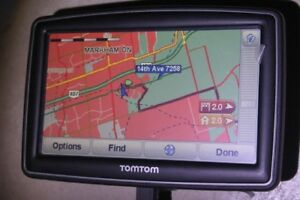 "TOMTOM XXL GPS w/ 5"" Screen a holder, a charger plus an Anti-The"