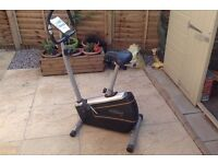 Tempo Exercise Bike, fully adjustable, little used.