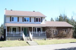 NEW PRICE - 4+ acres, 4 bed, 3 bath backing on to golf course!