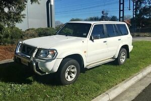 1999 Nissan Patrol GU TI (4x4) White 4 Speed Automatic 4x4 Wagon Melbourne CBD Melbourne City Preview