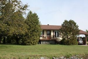 Noelville Raised Bungalow with 2 bedroom Apartment on 2 acres