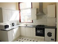 A bright and airy Double Room in trendy Queens Park. Zone 2. Bills included.