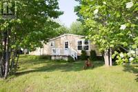 Two bedroom mini home in Pine tree park.