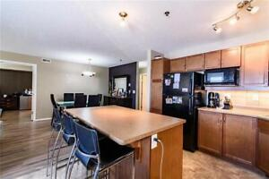 This Elegant corner unit comes with TWO PARKING SPOTS!